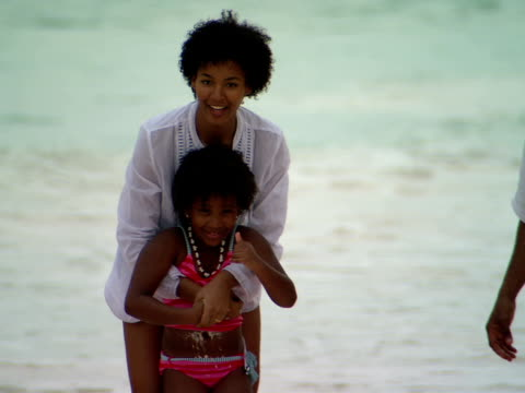 ms,  shaky,  mother and daughter (8-9 years) splashing in water on beach,  harbour island,  bahamas - 8 9 years stock videos & royalty-free footage