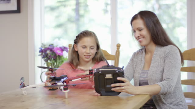 Mother and daughter studying drone technology at home