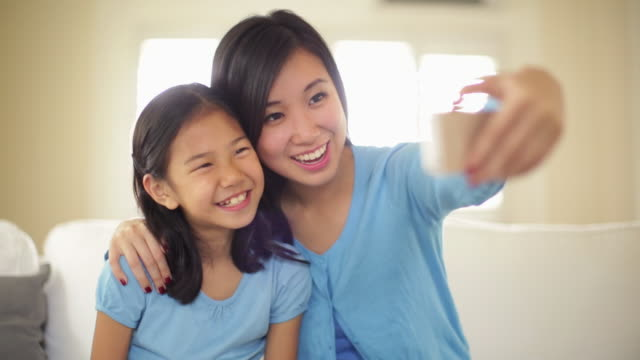 CU Mother and daughter taking a selfie.
