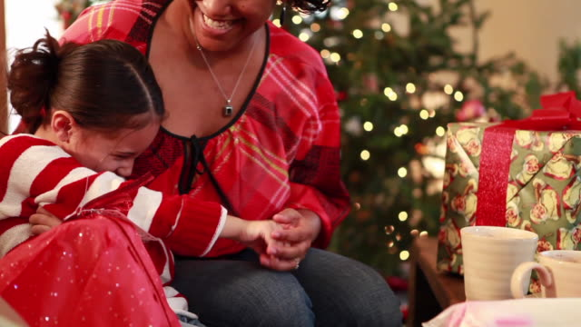 ms tu mother and daughter (6-7) tickling each other by christmas tree / lamy, new mexico, usa - lamy new mexico stock videos & royalty-free footage