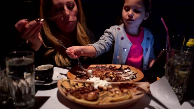 mother and daughter time - waffles stock videos and b-roll footage
