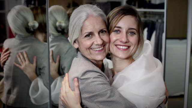 cu mother and daughter together shopping for wedding dress / new york city, new york, usa - abito da sposa video stock e b–roll
