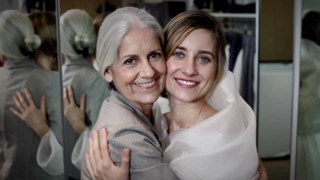 cu mother and daughter together shopping for wedding dress / new york city, new york, usa - daughter stock-videos und b-roll-filmmaterial