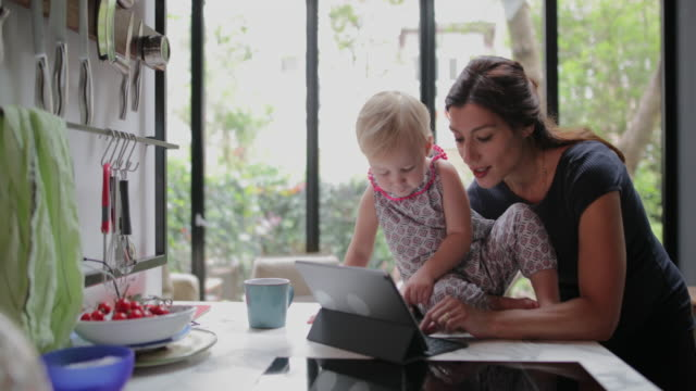 mother and daughter using digital tablet - telecommuting stock videos & royalty-free footage