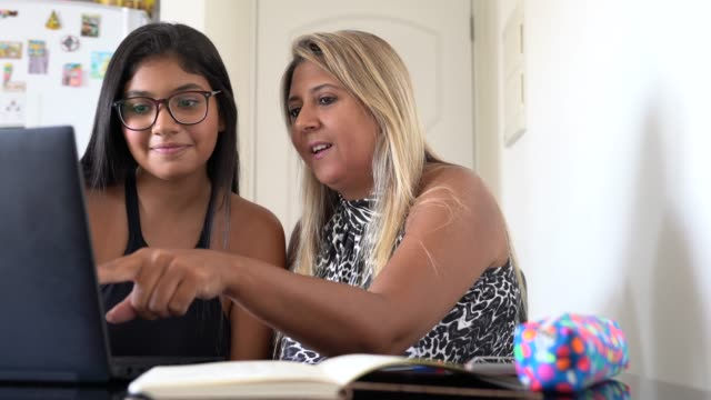 mother and daughter using laptop at home - homework stock videos & royalty-free footage