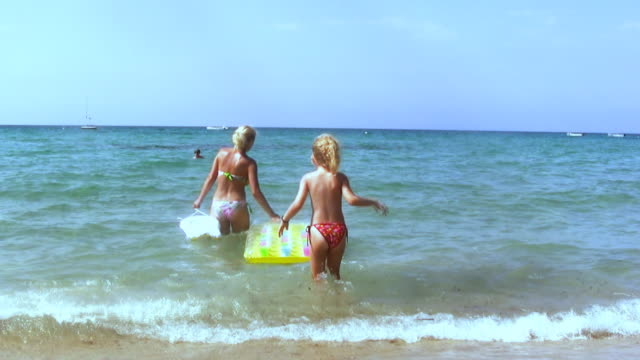 hd: mother and daughter - inflatable raft stock videos and b-roll footage