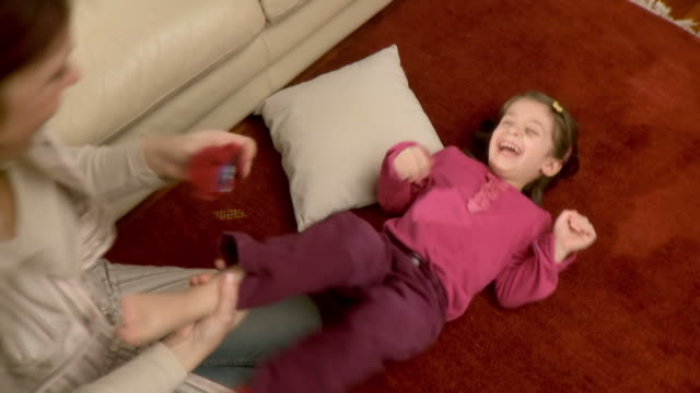 hd: mother and daughter - tickling stock videos & royalty-free footage