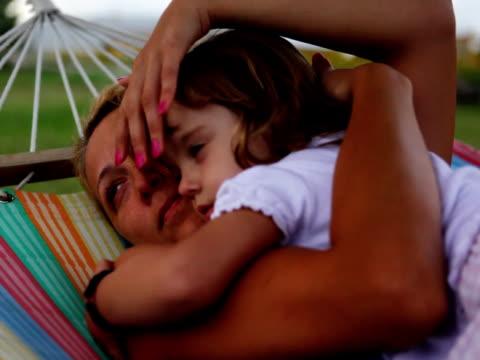 stockvideo's en b-roll-footage met ntsc: mother and daughter - schommelen schommelstoel