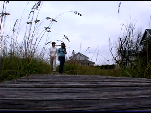mother and daughter walking on boardwalk - see other clips from this shoot 1335 stock videos and b-roll footage