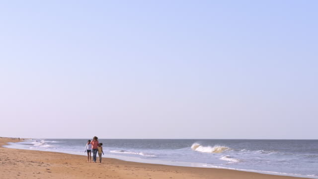 mother and daughters strolling on beach - virginia beach stock videos & royalty-free footage