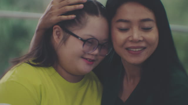 mother and down syndrome daughter embracing - position stock videos & royalty-free footage