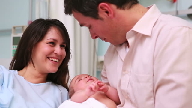mother and father holding a baby - 30 34 years stock videos & royalty-free footage