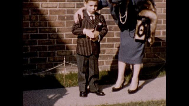 1957 Mother and Father With Nervous Son Holding Stuffed Animal