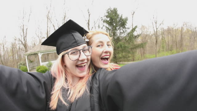 mother and graduate daughter funny selfies - graduation clothing stock videos & royalty-free footage