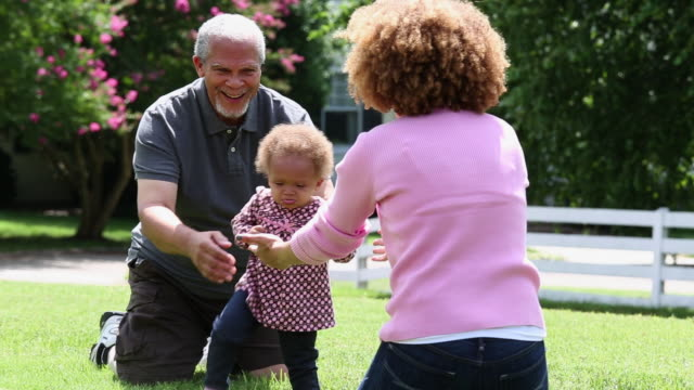 MS Mother and Grandfather Encouraging Toddler to Walk / Richmond, Virginia, United States