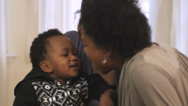 ms mother and grandmother cuddling toddler  / newark, new jersey, usa - african american ethnicity stock videos & royalty-free footage
