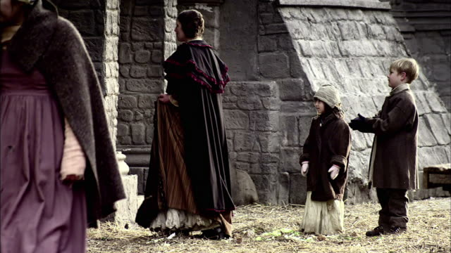 a mother and her children stop at a shop in london. - medieval reenactment stock videos & royalty-free footage