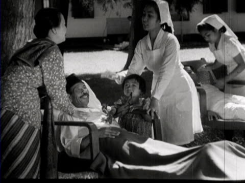 mother and her children visit their sick uncle in a hospital in the city - java stock videos & royalty-free footage
