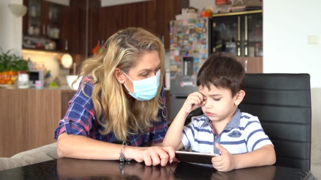 4k mother and her son using smart phone at home - remote location phone stock videos & royalty-free footage