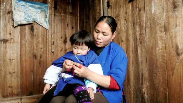 Mother and her young child on her lap in China