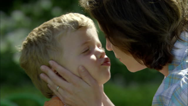 a mother and her young son kiss noses. - nose stock videos & royalty-free footage