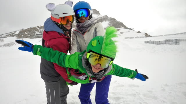 mother and kids having fun skiing in alps - ski holiday stock videos & royalty-free footage