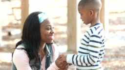 Mother and little boy, serious talk turns to smiles