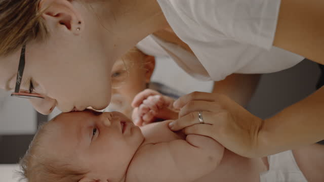 slo mo mother and little brother cuddles an infant boy - lying on back stock videos & royalty-free footage