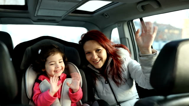 mother and little daughter on back seat in car - baby carrier stock videos & royalty-free footage