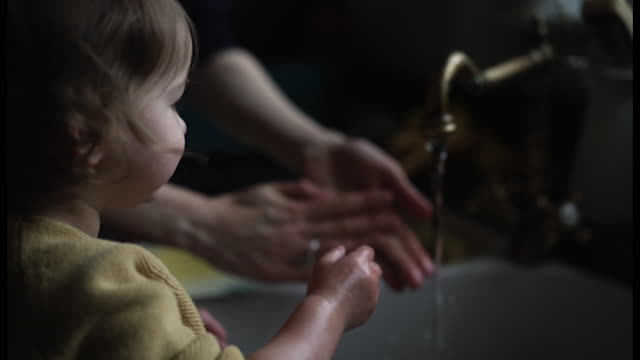 mother and little girl washing hands - two generation family stock videos & royalty-free footage