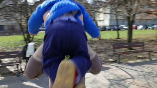 mother and little toddler in the park - adoption stock videos and b-roll footage