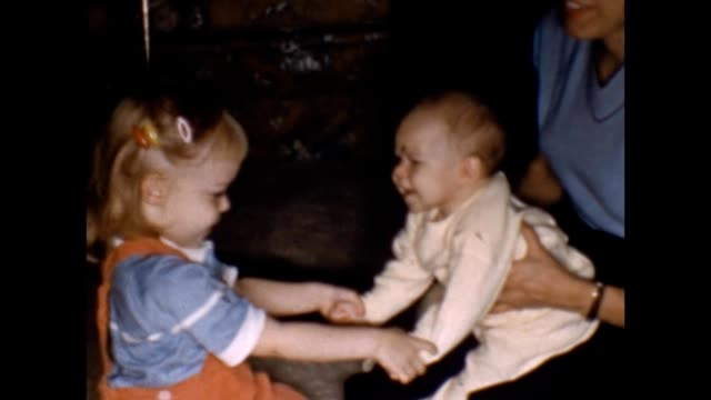 1958 Mother and Sister Playing With Baby