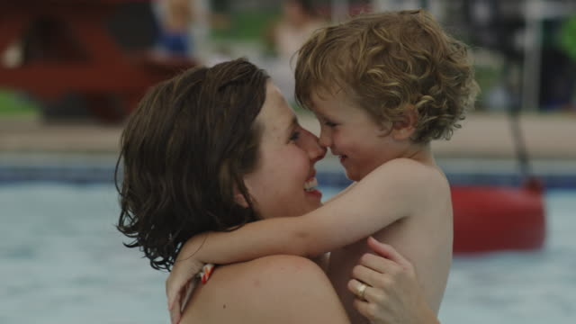 mother and son at a water park - water slide stock videos & royalty-free footage