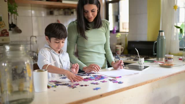 mother and son at home. - jigsaw puzzle stock videos & royalty-free footage