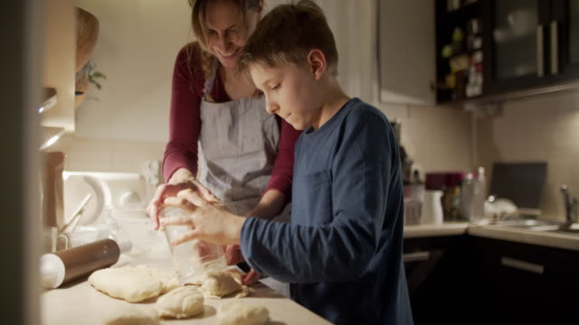 mother and son baking bread buns - poland stock videos & royalty-free footage