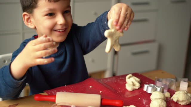 mother and son baking cookies together - sweet food stock videos & royalty-free footage