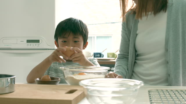 mother and son baking together - japanese mom stock videos & royalty-free footage