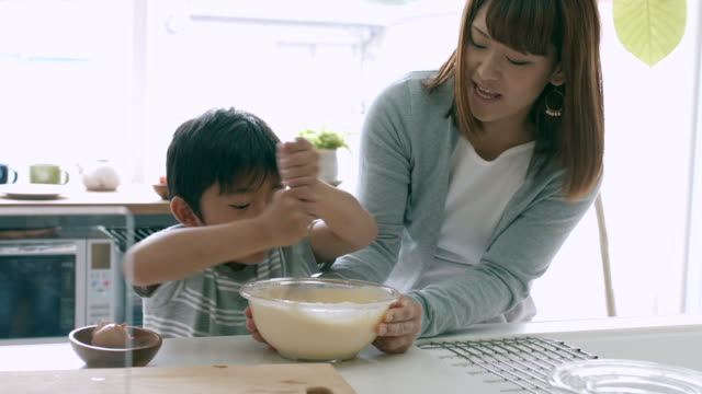 mother and son baking together - childhood stock videos & royalty-free footage