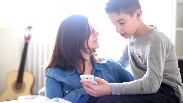 mother and son discuss at home - parent stock videos and b-roll footage