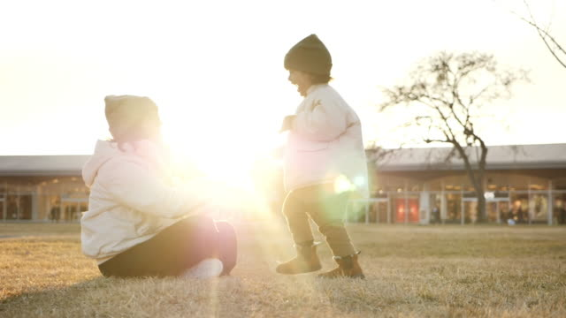mother and son embraces in the park. - two generation family stock videos & royalty-free footage