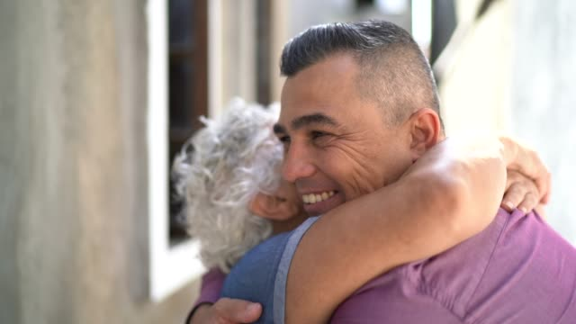 mother and son embracing at home - latin american and hispanic stock videos & royalty-free footage