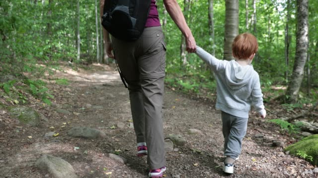 Mother and Son Exploring Forest on Hiking Trail