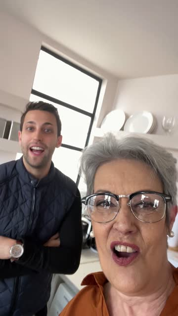 mother and son filming themselves dancing at home - mobile camera point of view - excitement stock videos & royalty-free footage