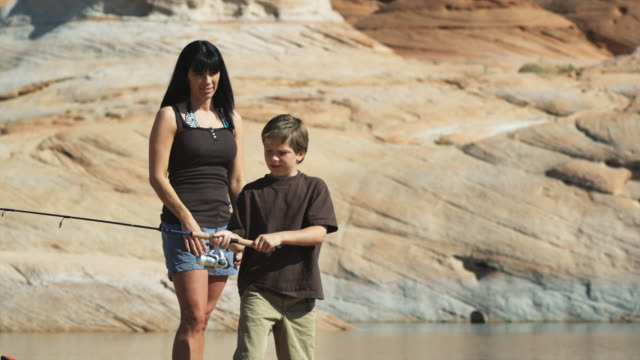 mother and son fishing - peruvian ethnicity stock videos & royalty-free footage
