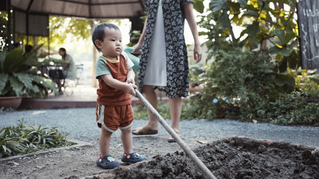 mother and son gardening together - agricultural activity stock videos & royalty-free footage