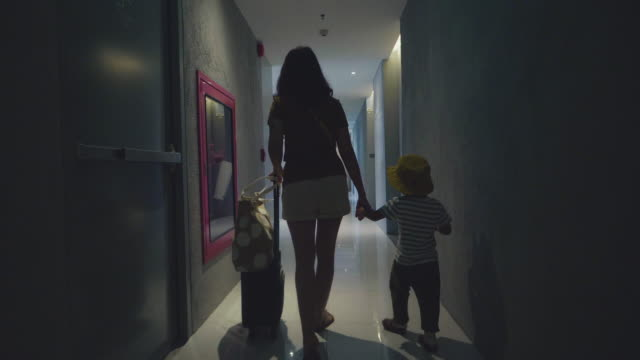 mother and son guest walking into hotel room - guest stock videos & royalty-free footage
