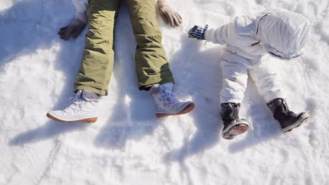 mother and son having fun in snow in japan. - ski resort stock videos & royalty-free footage
