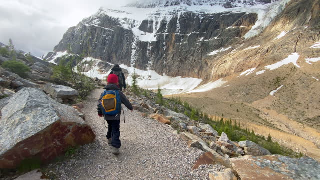 mother and son hiking at mount edith cavell, jasper, alberta, canada - alberta stock videos & royalty-free footage
