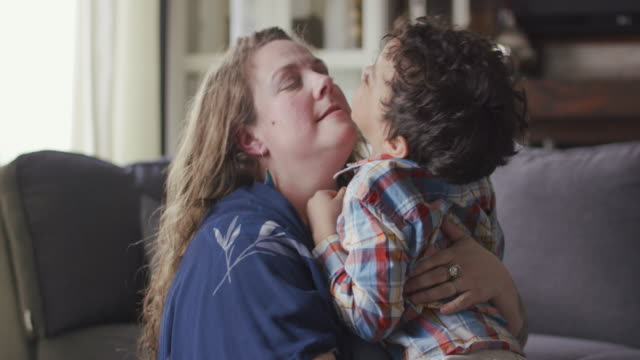 a mother and son hug affectionately - cosy stock videos & royalty-free footage