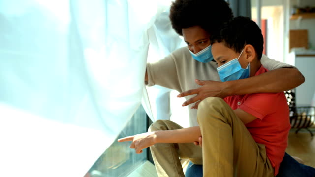 mother and son in pandemic quarantine. - offspring stock videos & royalty-free footage